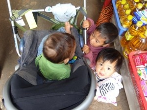 Children in Myanmar peering into stroller