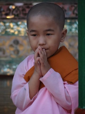 young child nun praying