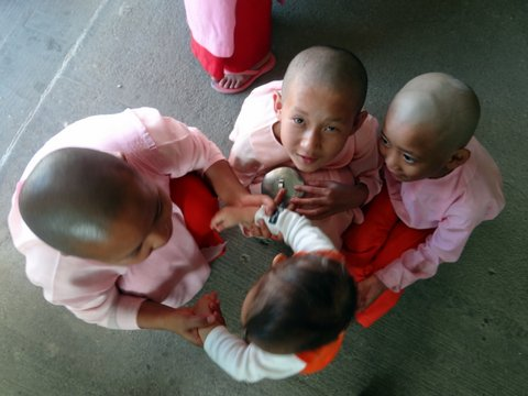 child nuns holding baby by the hands