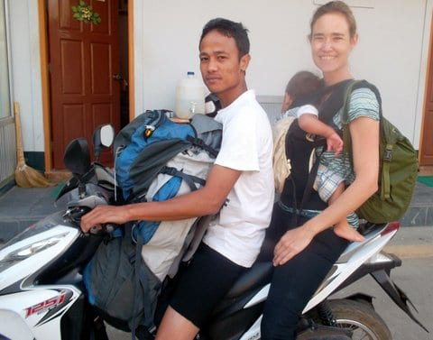 On a motorcycle with the baby and a backpack in Myanmar