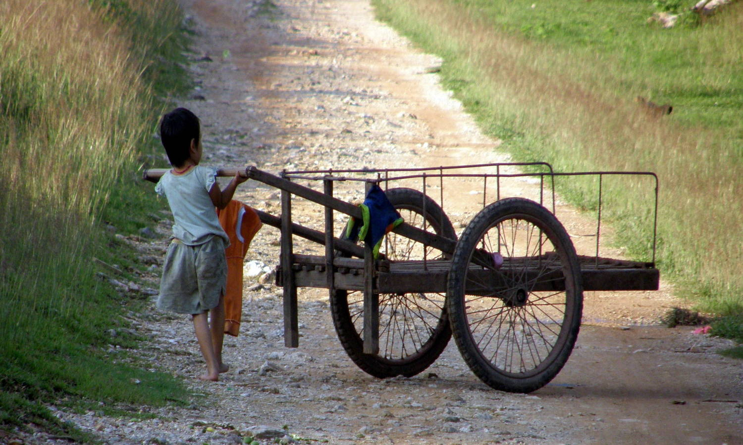 Girl pushing cart, Travel Alone as a Woman