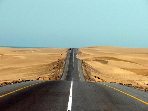 road separating desert and beach
