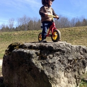 small child on a slider on top of rock, an ode to Nicolai