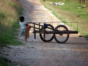 Girl pushing cart, Travel Alone as a Woman